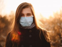 Portrait,Of,Happy,Young,Woman,Wearing,Protective,Face,Medical,Mask