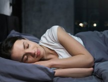 Young,Female,Sleeping,Peacefully,In,Her,Bedroom,At,Night,,Relaxing