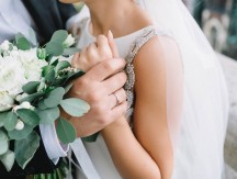 Close-up,Of,Groom's,Hand,Holding,Bride's,Wirst,Tender