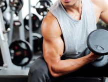 Fit,Strong,Man,Doing,Biceps,Curl,In,Gym