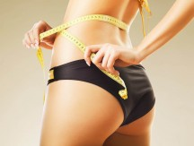 Slimming,Woman,In,Panties,With,Yellow,Measure