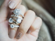 Close,Up,Of,An,Elegant,Diamond,Rings,On,Woman,Finger.love