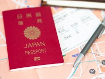 Travel,Or,Tourism,Concept.,Japanese,Passport,On,Map