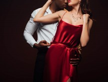 Partial,View,Of,African,American,Man,Embracing,Woman,In,Red