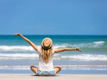 Happy,Woman,Traveler,Relaxing,On,A,Perfect,Beach