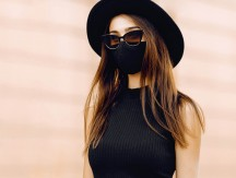 Beautiful,Girl,In,A,Black,Medical,Protective,Mask,On,Her