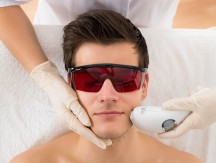 Close-up,Of,Beautician,Giving,Laser,Epilation,Treatment,To,Young,Man