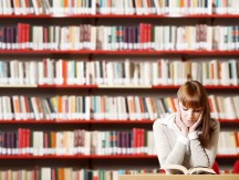 Portrait,Of,A,Serious,Young,Student,Reading,A,Book,In