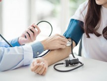 Doctor,Using,Sphygmomanometer,With,Stethoscope,Checking,Blood,Pressure,To,A