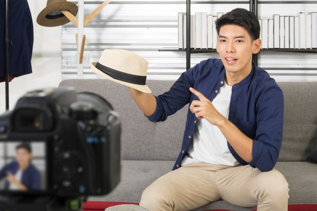 Young,Asian,Man,Blogger,Present,And,Review,Hat,On,Live