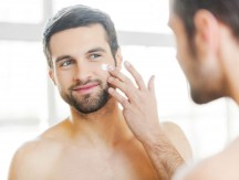 Skin,Care.,Handsome,Young,Shirtless,Man,Applying,Cream,At,His