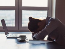 Tired,Businesswoman,Sleeping,On,Table,In,Office.,Young,Exhausted,Girl